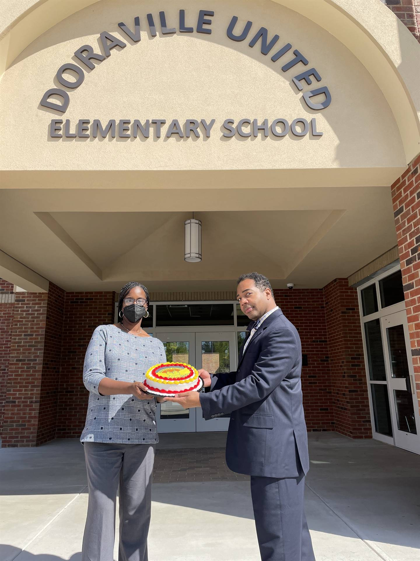 Dr. Berger and Dr. Jackson with Teacher Appreciation Cake